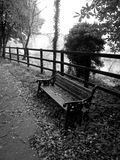 Black and white bench on the street. Black and white photo of the bench on the street Royalty Free Stock Photography