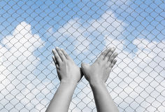Black and white of bird hand sign inside fence Royalty Free Stock Photography