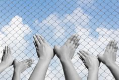 Black and white of bird hand sign inside fence Stock Photo