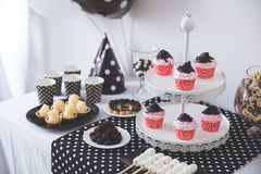 Black And White Birthday party decoration. Portrait of Black And White Birthday party decoration with full of cake and sweet candy Royalty Free Stock Photo