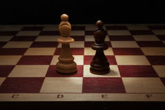 Black and White Bishop on chess board. Stock Photos