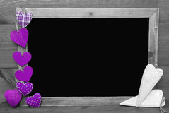Black And White Blackbord With Purple Hearts, Copy Space Stock Images