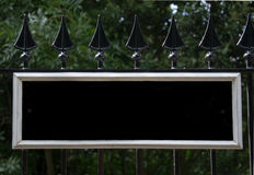 Black and White Blank Sign Mounted on Black Railings Stock Photography