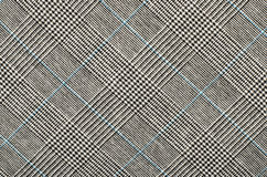 Black and white with blue houndstooth pattern in squares. Royalty Free Stock Images