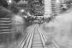 Black and white blur image of Traveler crossing bamboo bridge or Mon Bridge in Sangklaburi. Kanchanaburi, Thailand. Royalty Free Stock Image