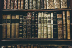 Black and White Books on Brown Wooden Shelf Royalty Free Stock Photography