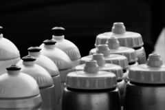 Black and white bottles. Close up in black and white with some bottles royalty free stock image
