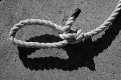 Black and white bowline gauze on marine rope. And shadow stock image