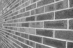 Black and white brick background fading into the distance Royalty Free Stock Image