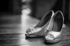 Black and white bride wedding shoes. On wood floor Royalty Free Stock Image