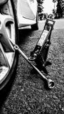 Broken Car Jack. Black and white broken car jack royalty free stock image
