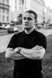 Black and white brutal portrait of a fashionable man outdoor in the city Stock Photos