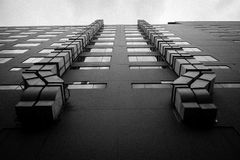 Black and white building in the ant eye view with film grain. Black and white picture of building in the ant eye view with film grain royalty free stock photos