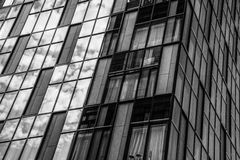 Black and white building. Architecture with schedule panel royalty free stock photos