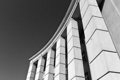 Black and white building with columns. Stock Images