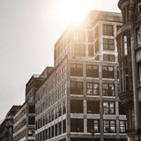 Black and white building. Modern office building with sunlight Stock Photos
