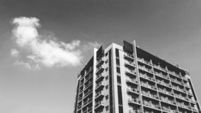 Black and white building with cloud and white sky stock image