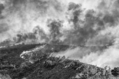 Black and White Burning Landscape during California Fires. Black and white image of burning landscape with flames and smoke during California brushfire royalty free stock images