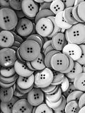 Black and white buttons background. Plastic buttons background. Black and white photo Royalty Free Stock Photos
