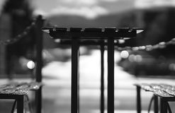 Black and white cafe table with benches backdrop. Hd Stock Images