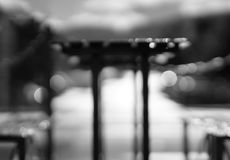 Black and white cafe table with benches bokeh background. Hd Royalty Free Stock Image