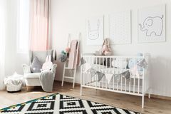Scandi child`s room with armchair Stock Images