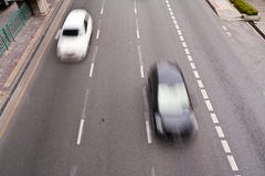 Black and white cars running on the road Royalty Free Stock Images