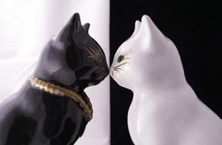 Black and white cats. Black and white sculptures of cats Stock Image