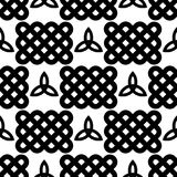 Black and white celtic style seamless pattern. Traditional celtic style braided knots and triquetra symbols seamless pattern. Irish St. Patrick`s day vector Royalty Free Stock Photography