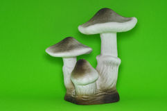Black & white ceramic mushroom isolated in green background. 3 mushrooms in a stack Stock Image