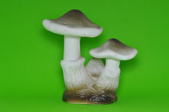 Black & white ceramic mushroom isolated in green background. 3 mushrooms in a stack Stock Photos