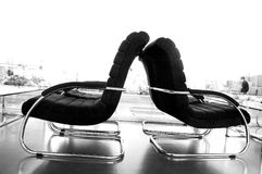Black and white chairs. Chairs back to back Royalty Free Stock Photos