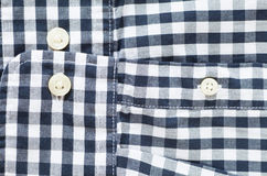 Black and white check shirt sleeve and button Royalty Free Stock Photo