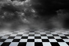 Black And White Checker floor Grunge Room. Checker floor lead into dark empty space royalty free stock images