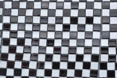 Black and White Checkerboard Abstract Texture. Black and white glass tile arranged in a checkerboard pattern for abstract texture background Stock Images