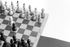 Black & white checkerboard with figures on black white background Royalty Free Stock Photo