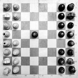 Black & white checkerboard with figures on white background Stock Image