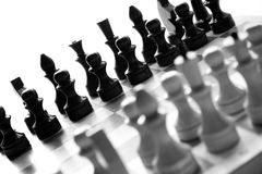 Black & white checkerboard with figures on white background Royalty Free Stock Images