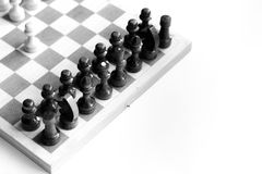 Black & white checkerboard with figures on white background Royalty Free Stock Photos