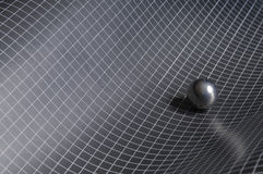 Black, white checkered background with steel ball Royalty Free Stock Photos