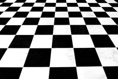 Black and white checkered floor. Black and white checkered linoleum floor receding into the distance Stock Photography