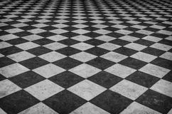 Black and white checkered marble floor Stock Images