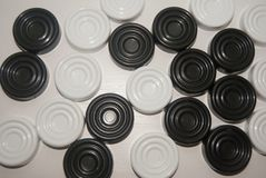 Black and white checkers. On a white background royalty free stock photography
