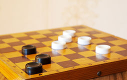 Black and white checkers on a chess board Stock Photography