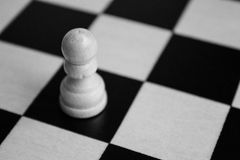 Black and white chess board with a single pawn Royalty Free Stock Image