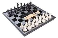 Black and white chess and checkers on a black and gray chessboard, on a white background, isolate. Board game stock image