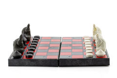 Black and white chess with chess board on white background Royalty Free Stock Images