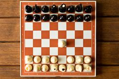 Black and white chess on the chessboard. The beginning of the ch stock images