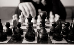 Chess move. Black and white chess concept with man make move royalty free stock photos