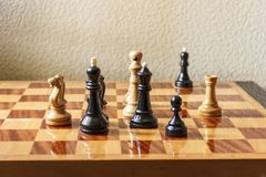 Black and white chess pieces on a chessboard. Stock Photo